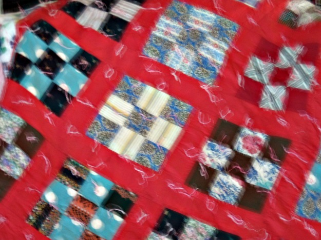 Tied quilt my mother-in-law made, probably in the late 30's. The 9patch's are flour sack fabric.