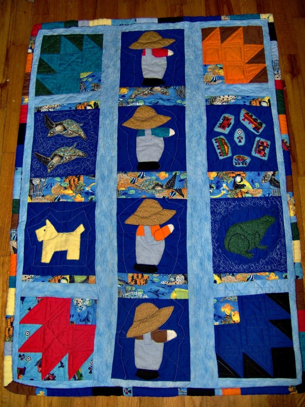 Applique, using zig zag stitching and pieced quilt for the grands.