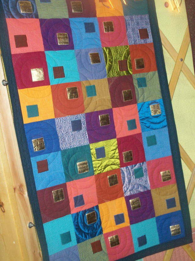One of the quilts on the inside of the yurt